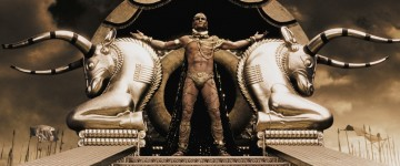 Xerxes (RODRIGO SANTORO), the Persian king who claims to be a god, stands atop his elaborate golden litter in Warner Bros.